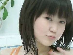 Bathing Asian Teen Masturbates Erotically